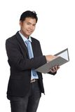 Asian businessman point to a folder and smile Royalty Free Stock Photo
