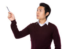 Asian businessman point up with a pen Royalty Free Stock Images