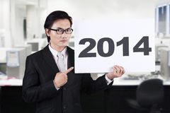 Asian businessman pointing a 2014 billboard Royalty Free Stock Photos