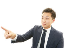Asian businessman pointing Royalty Free Stock Photo