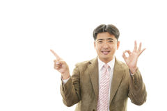 Asian businessman pointing Stock Images