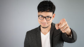 Asian businessman pointing on you. Stock Photography
