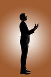Asian businessman praying Royalty Free Stock Photo