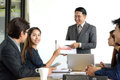 Asian businessman present financial chart with team Stock Image