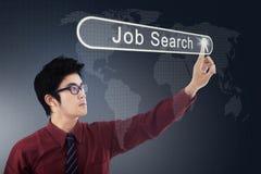 Asian businessman pressing a job search button Stock Photos