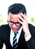 Asian Businessman are pressured to work. And unsuccessful Royalty Free Stock Photos