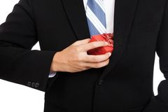 Asian businessman pull a gift box from his suit Royalty Free Stock Photos