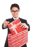 Asian businessman pull gift box from shopping bag Stock Image
