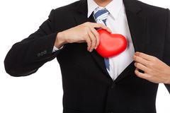 Asian businessman pull red heart  from his suit Royalty Free Stock Images