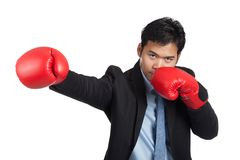 Asian businessman punch with red  boxing glove Royalty Free Stock Images