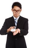 Asian businessman put medicine in his hand Stock Photos