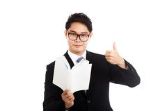 Asian businessman read a book show thumbs up Royalty Free Stock Images
