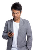 Asian businessman read on cellphone Royalty Free Stock Images