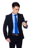 Asian businessman read the message on smart phone Royalty Free Stock Image