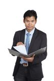 Asian businessman read paper on a folder Stock Photo