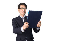 Asian businessman reading important information in file folder, Royalty Free Stock Photography