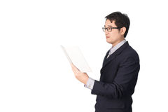 Asian businessman reading notebook or diary for checking, isolat. Ed on white background Royalty Free Stock Photos
