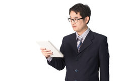 Asian businessman reading notebook or diary for checking, isolat. Ed on white background Stock Photography