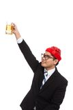 Asian businessman with red  christmas hat cheers with mug of bee Royalty Free Stock Photos