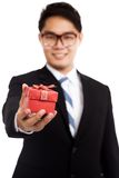 Asian businessman with red gift box focus on box Royalty Free Stock Photo