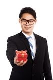 Asian businessman with red gift box Stock Images