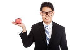 Asian businessman with red gift box  on palm hand Royalty Free Stock Photo