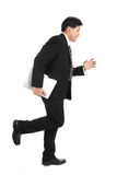 Asian businessman running for do the job Royalty Free Stock Image