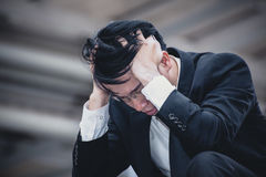 Asian businessman sad worry tired and headache, stress at workpl Stock Photo