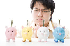 Asian businessman saving money Royalty Free Stock Images