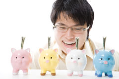 Asian businessman saving money Stock Photo