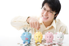 Asian businessman saving money Royalty Free Stock Photography