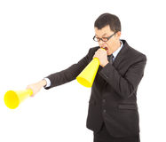Asian businessman screaming with cheering Megaphone. Over white Royalty Free Stock Images