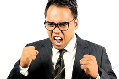 Asian businessman screaming. On a white background stock photography
