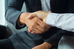 Asian businessman Shake hands with business woman royalty free stock images