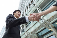 Asian businessman shaking hand Stock Photos