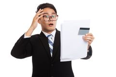 Asian businessman shock with a credit card and  statement Royalty Free Stock Photography