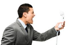 Asian businessman shouting in phone Royalty Free Stock Photos