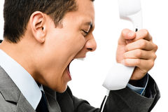 Asian businessman shouting in phone Royalty Free Stock Photography