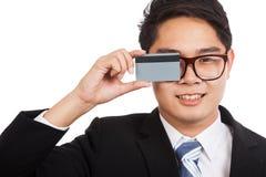 Asian businessman show a blank card cover his eye Stock Photos