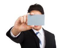 Asian businessman show a blank card cover his face Stock Photo
