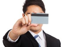 Asian businessman show a blank card cover his face Stock Images