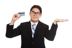 Asian businessman show a card and his palm hand Royalty Free Stock Photos