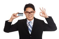 Asian businessman show OK with a card Stock Photos