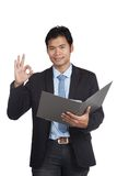 Asian businessman show OK sign with a folder Stock Photo