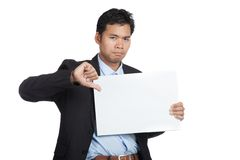 Asian businessman show thumbs down with blank sign Royalty Free Stock Photo