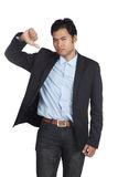 Asian businessman show thumbs down Royalty Free Stock Photography