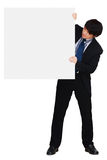 Asian businessman showing blank signboard Stock Image