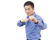 Asian businessman showing karate move Stock Photos