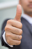 Asian businessman showing thumb up Royalty Free Stock Photos