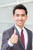 Asian businessman showing thumb up Stock Image